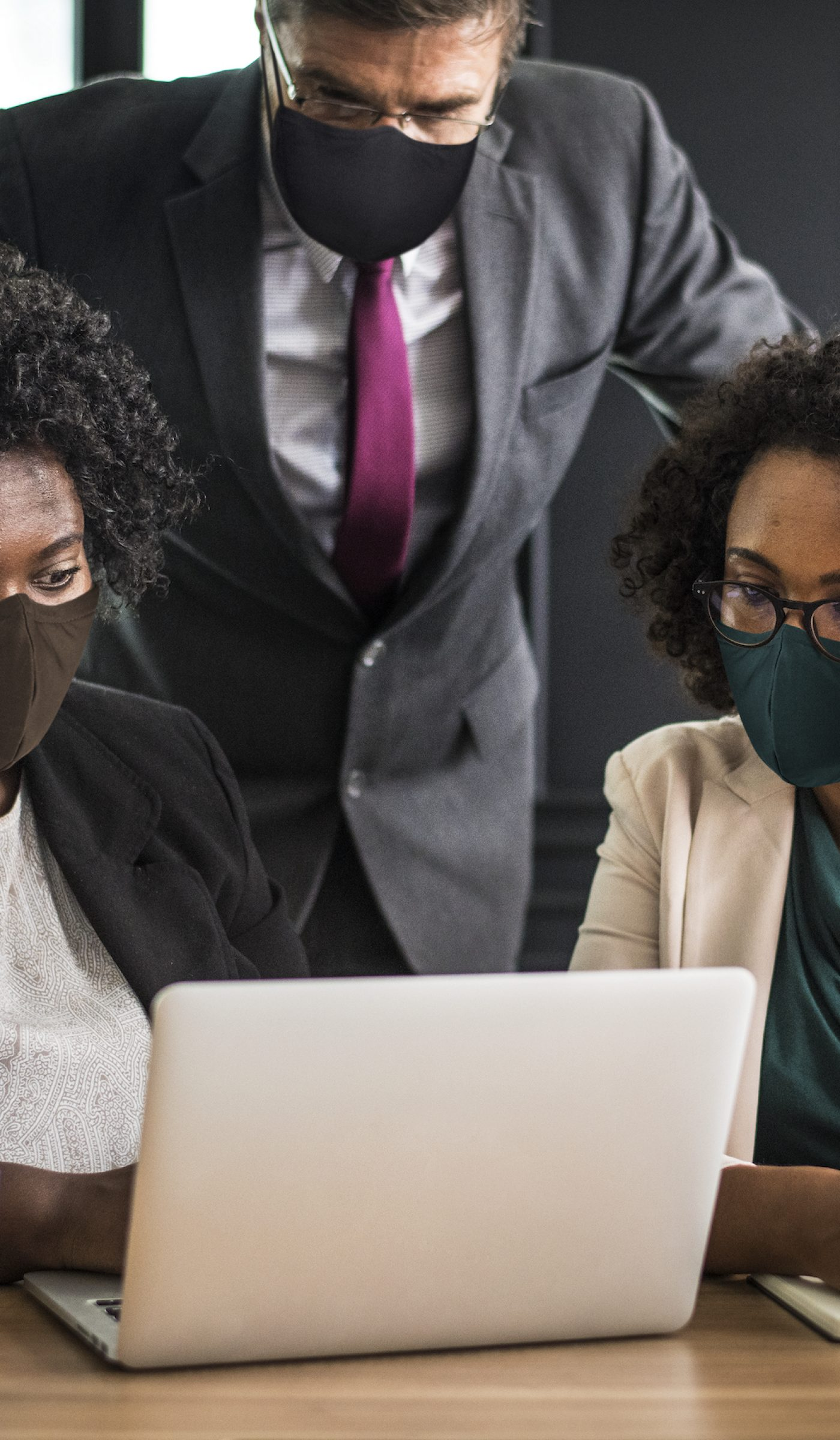 Business new normal, people wearing masks in the office